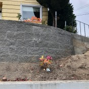 New Retaining Wall and Early Plantings - stacked wall above the original poured wall