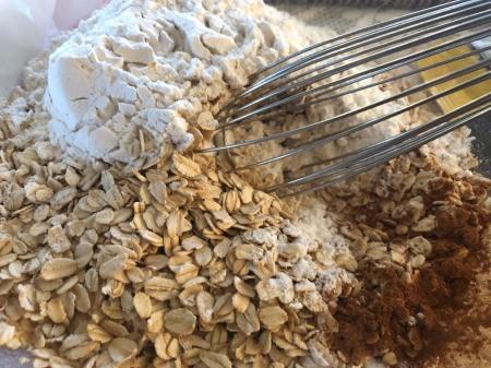 mixing oats, flour & cinnamon