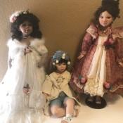 Three porcelain dolls.