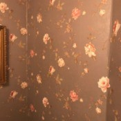 Discontinued York Wallpaper - pink roses on brown or dusky purple background