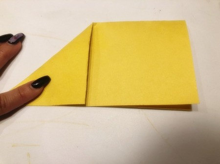 3D Kirigami Paper Stars - fold top left corner down to form a triangle, unfold