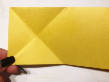 3D Kirigami Paper Stars - folded X created on the left side of the paper