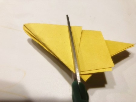 3D Kirigami Paper Stars - cut across and into the triangle on the left side and remove all of the paper on the right side