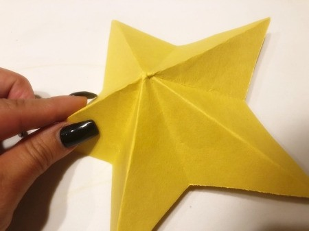 3D Kirigami Paper Stars - reinforce creases so main bits of the star are down and pieces in between are folded up