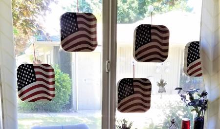 Patriotic Window Display - plates hanging in the window