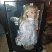 Value of an Ashley Belle Doll - doll in a white dress with what appear to be wings