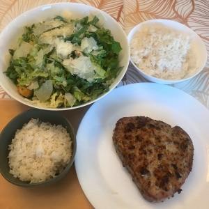 rice, salad and tuna steak on plate