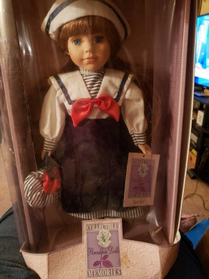 Value of a Collectible Memories Porcelain Doll - doll in sailor outfit