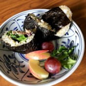 Tuna Mayo Onigiri with fruit on plate