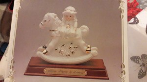 Identifying a Leornado Collection Figurine - white and gold figurine of a girl on a rocking horse