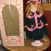 Value of a Brass Key Rose Collection Doll - doll standing next to box