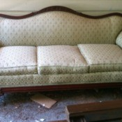 Value of an Antique Couch - upholstered couch with wood trim on back, arms, front, and feet