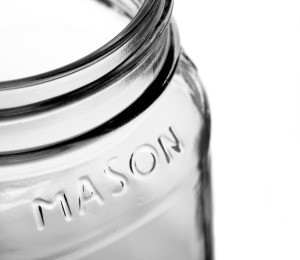An empty mason glass jar.