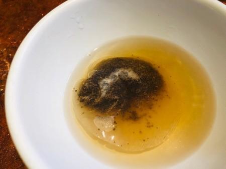 Soaking the tea bag in the salt water.