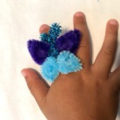 Pipe Cleaner Butterfly Ring - child's hand wearing the ring