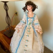 Identifying a Porcelain Doll - doll wearing colonial dress