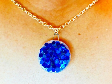 Making a Bottle Cap Glitter Pendant Necklace - finished pendant being worn