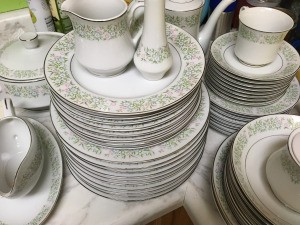 Value of Dinnerware Made in Japan - white dinnerware with a pink, green, and blue floral design around the edge