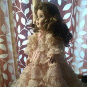 Identifying a Porcelain Doll - doll wearing a layered lace dress