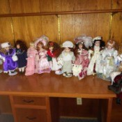 Selling a Porcelain Doll Collection  - dolls on a shelf
