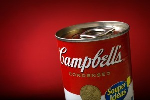 A can of Campbell's soup on a red background.