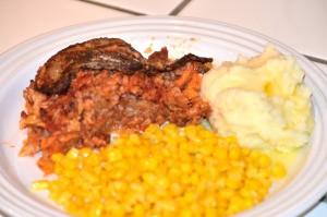 Stuffed Cabbage Casserole on plate with corn & potatoes