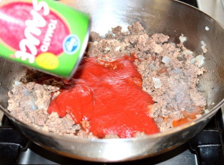 adding tomato sauce to pan
