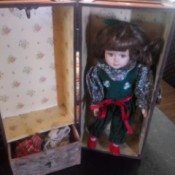 Identifying a Porcelain Doll - small doll in a carrying trunk with clothes hanging area and drawer