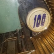 Value of a Seeburg Jukebox - closeup of the emblem with 100 on it