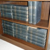 Selling Antique Incomplete Set of Encyclopedia Britannica - volumes on a bookshelf