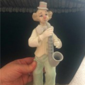 Value of a Leonardo Clown Figurine - muted color sax playing clown