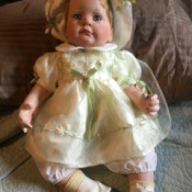 Identifying a Porcelain Doll - baby doll with bonnet and hightop baby shoes