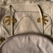 Cleaning Discoloration and Stains on a Leather Bag - light cream/tan bag with stains and noticeable color differences