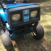 Value of an Old Lowes Yard Tractor by Dynamark - front end of a blue lawn tractor