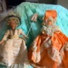 Identifying Dolls with Hard Plastic Bodies - two dolls in fancy dresses one has a parasol