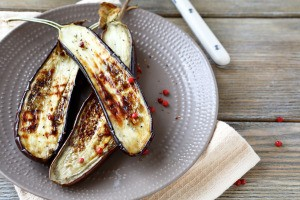 Grilled eggplant halves on a plate