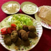 Falafel on plate with sauces & crackers