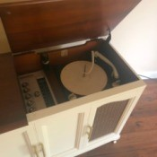 Identifying a Vintage Stereo Console - view of turntable inside a white stereo console