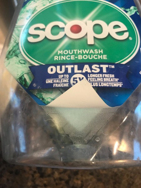 Repupose Mouthwash Container into a Planter - peel off the label