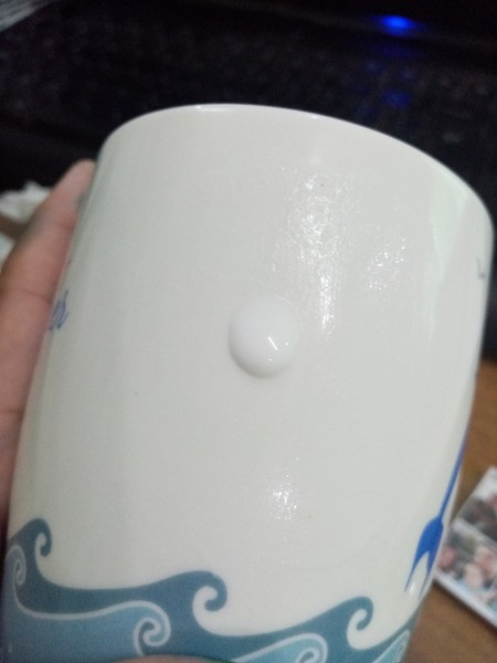 Photo Transfer Using White Glue - apply white glue to the area where you want the photo on the mug and spread