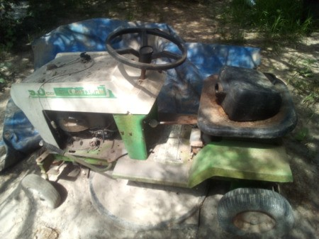 Value of a 1960 Sears Craftsman Riding Mower - old green and white riding mower
