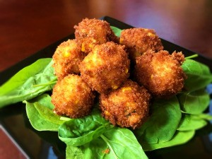 Crispy Grits Fritters on spinach