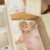 Value of Ashton Drake Dolls - doll in Stryofoam packing material with certificates