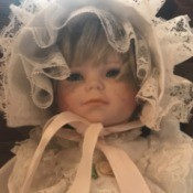 Value of a Towle Porcelain Doll - baby doll in christening dress