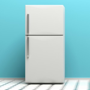 A white refrigerator with a teal wall behind.