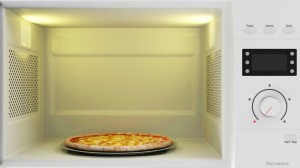 A pizza in the microwave.