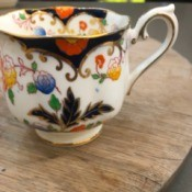 Value of Bognor Prince Albert China - white tea cup with gold trim and a floral pattern