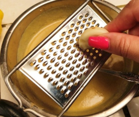 grating garlic into dressing