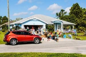 A garage sale in a front yard.