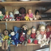 Identifying Old Dolls - a variety of old dolls on a shelf